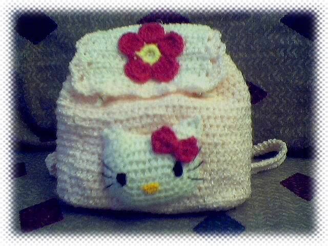 Knitting-and has created a crochet Hello Kitty bag red and black.